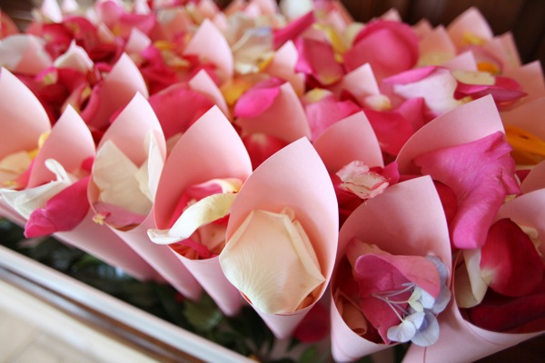 Rose of paper cones held heavenly-scented rose petals for guests to shower us as we left for the honeymoon.
