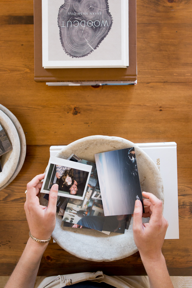 Fill a bowl with polaroids on your coffee table
