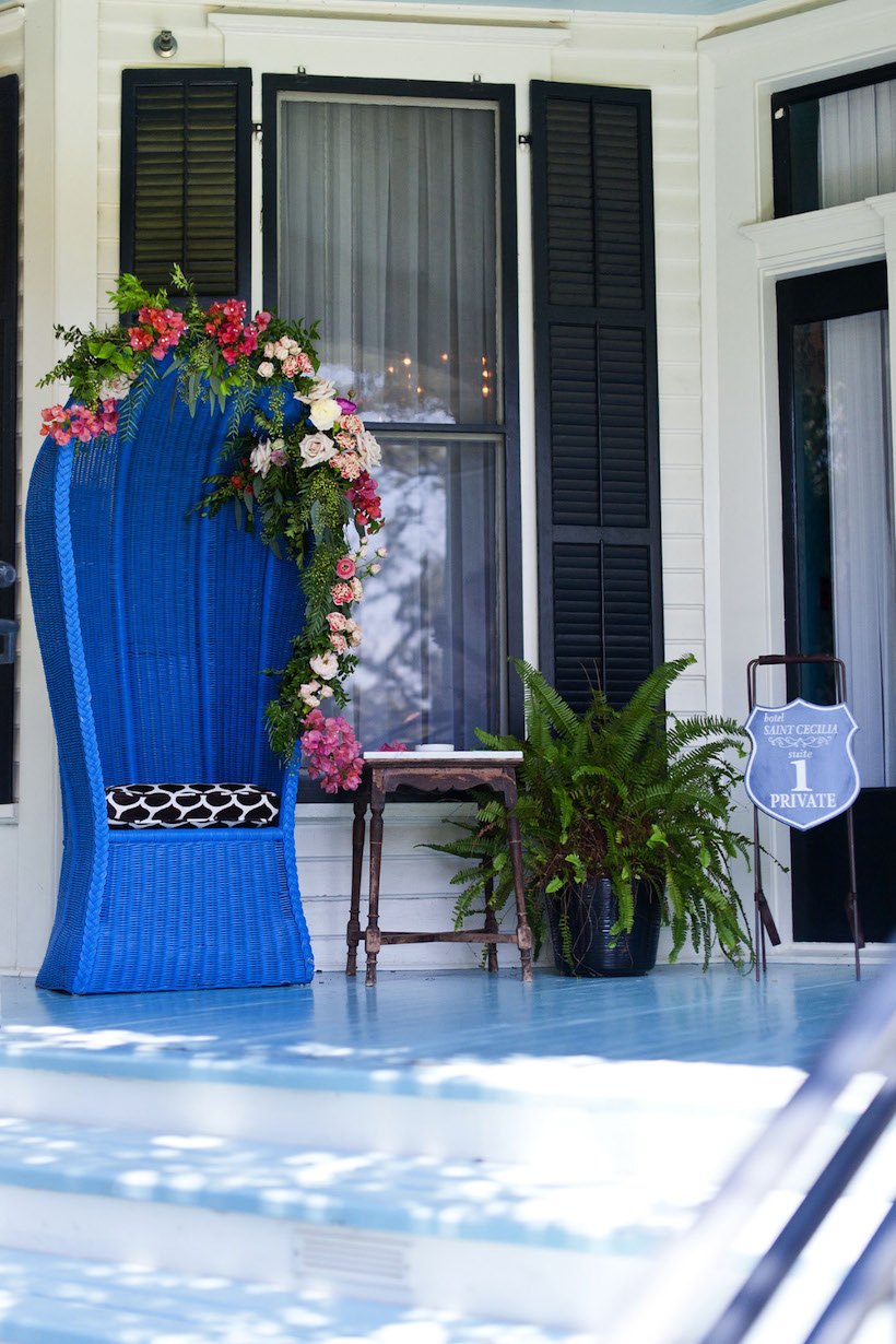 Flower Garland on Blue Wicker Chair