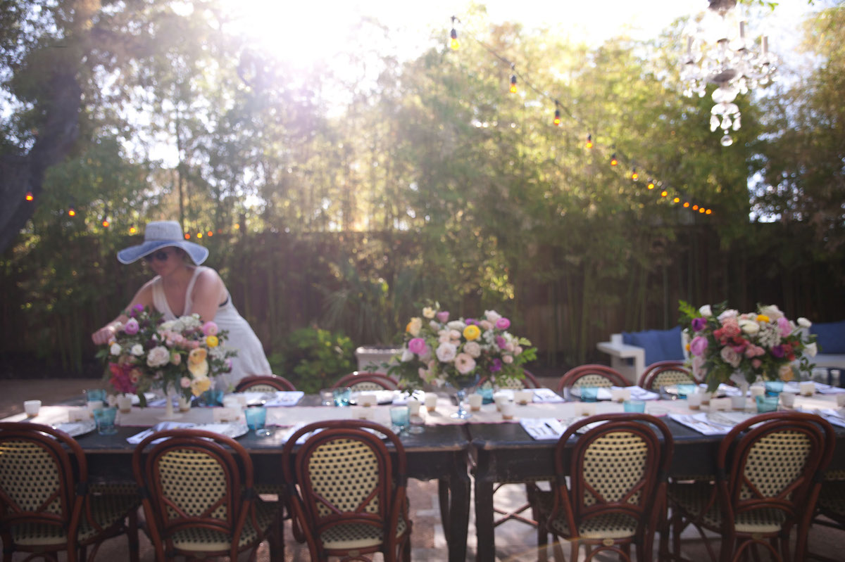Floral Designer Setting Up for an Outdoor Dinner Party