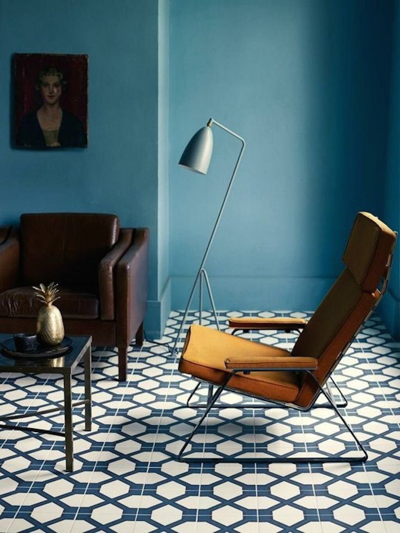 Blue Living Room With Bold Tile And Mid Century Modern Lounge Chair