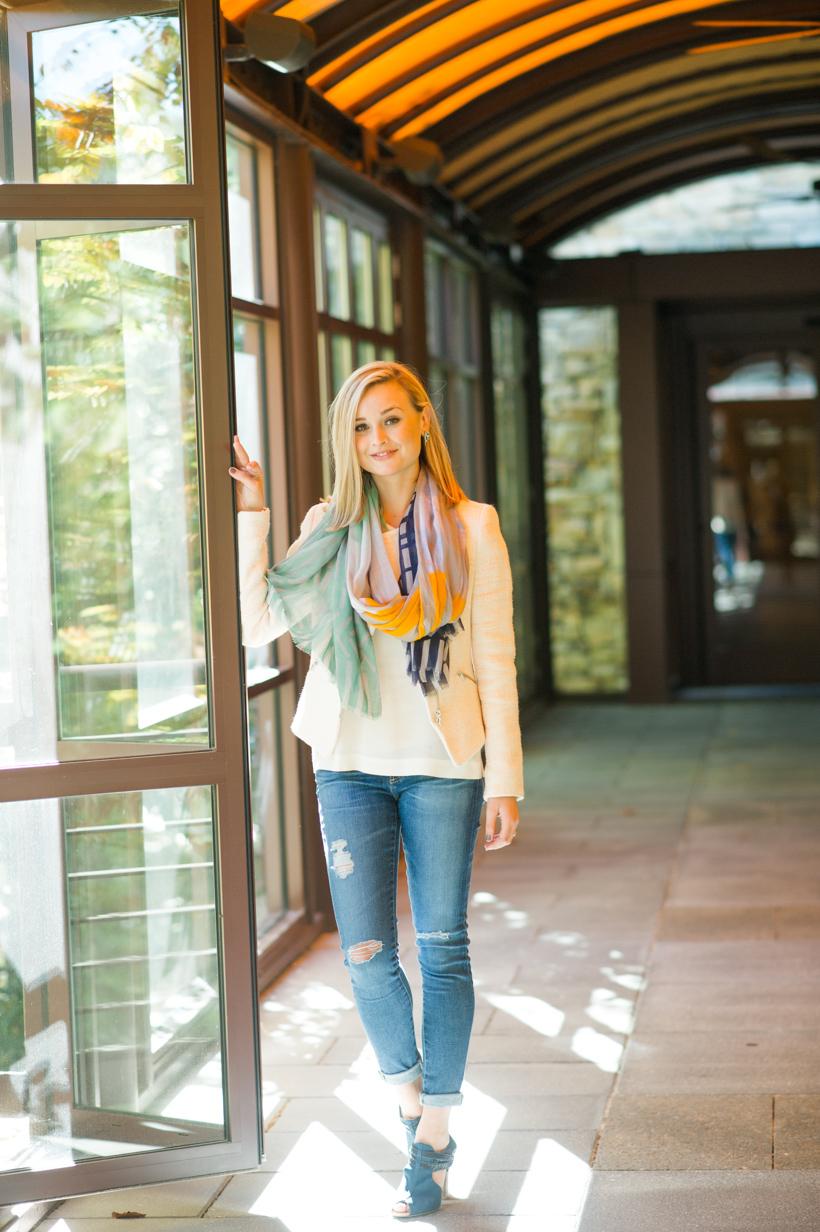 colorful scarf over blush jacket