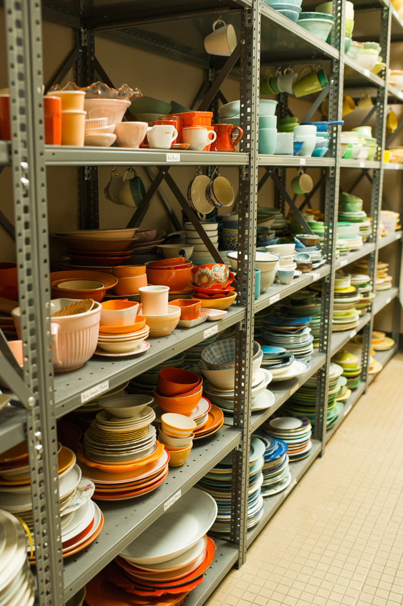 colorful dishes in prop closet at Southern Living