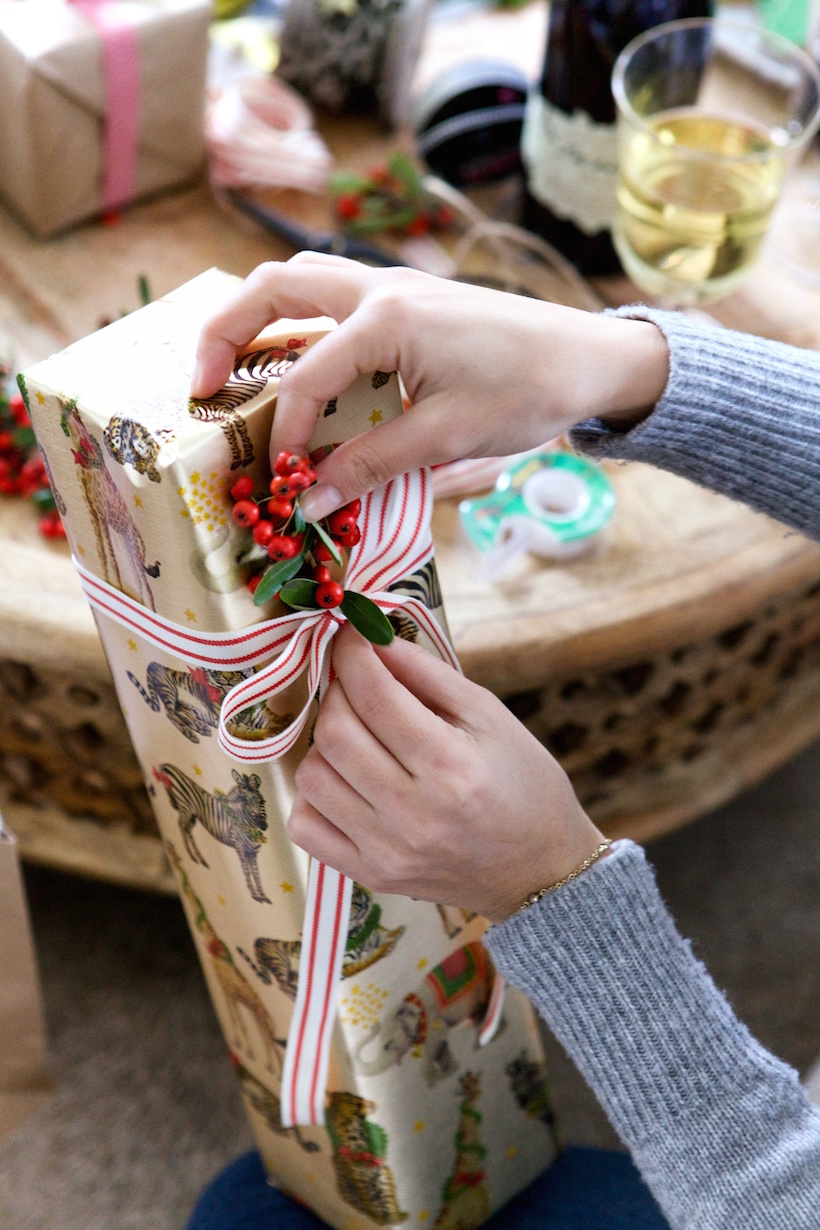 Add berries to your wrapped holiday presents