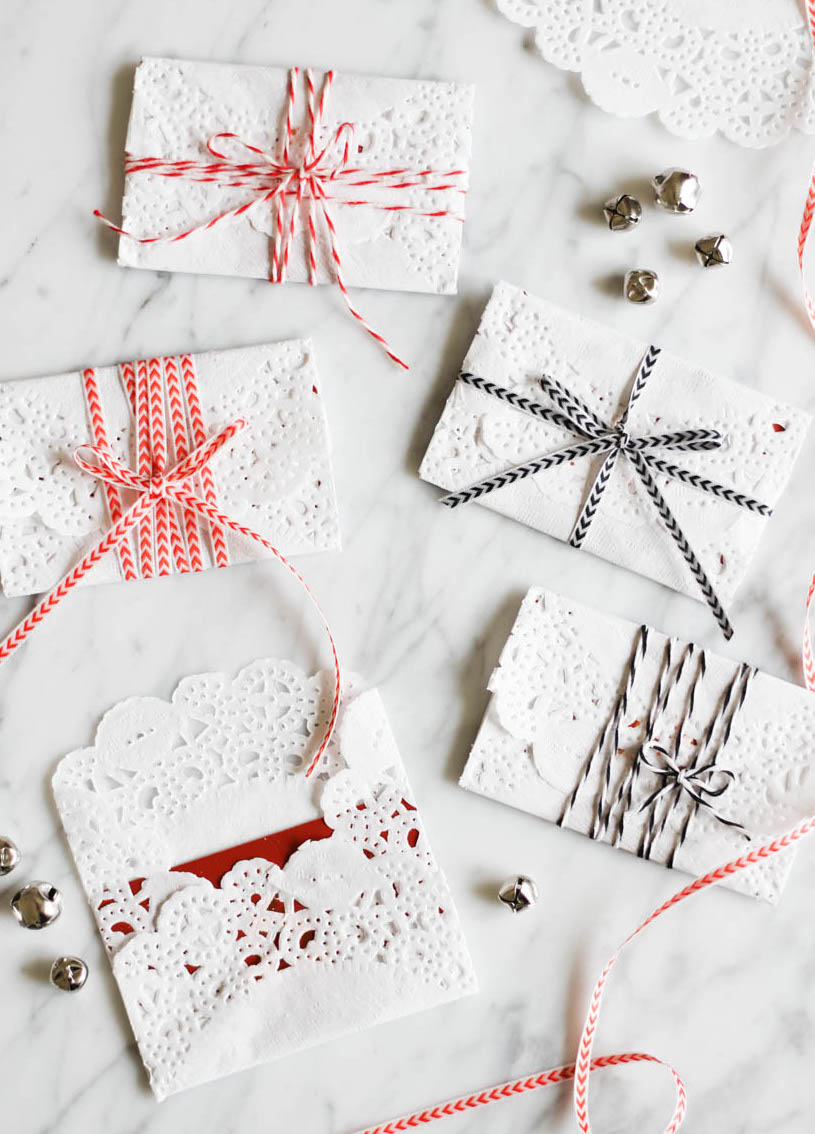 Wrap gift cards with paper doilies and ribbon