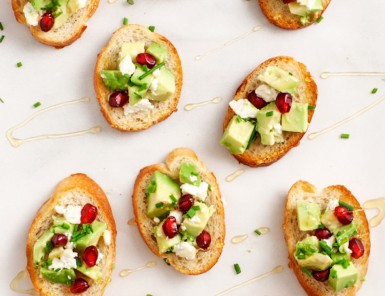 avocado and pomegranate crostini