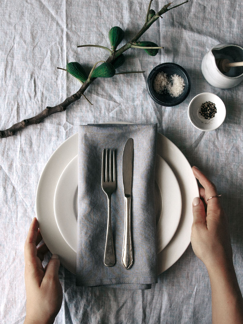 neutral place setting with foraged greens