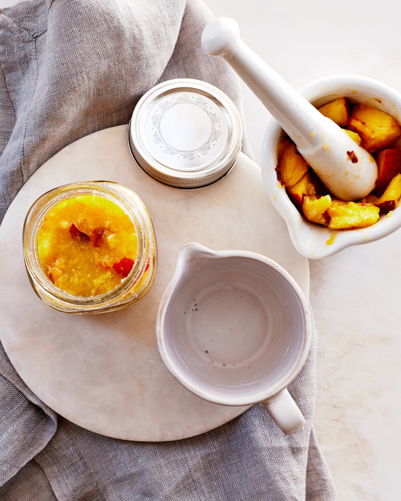 Make a homemade toner with a ripe peach and coconut water