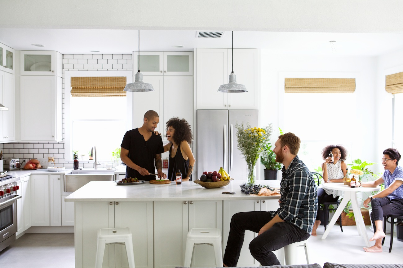 white kitchen island with bar stools