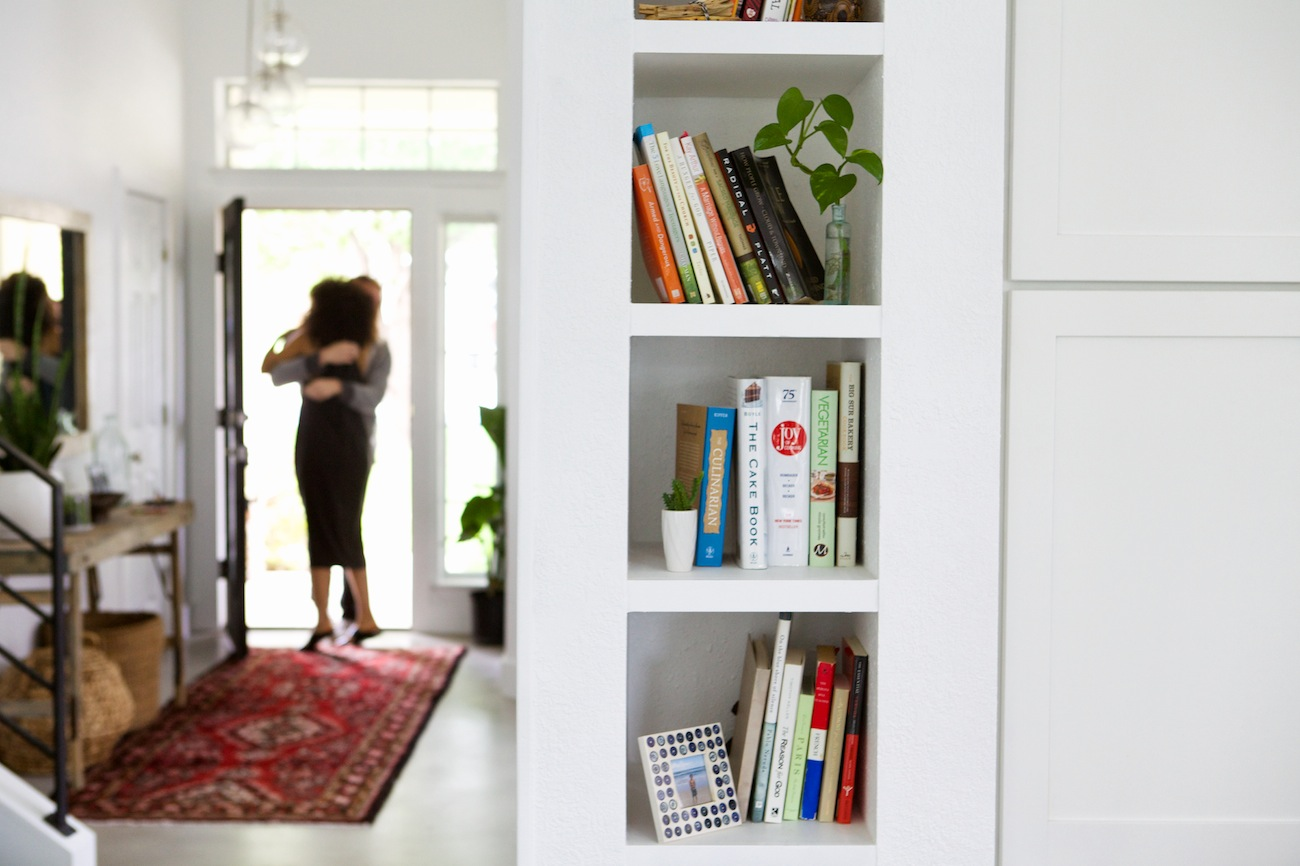 book shelf and tribal rug entryway
