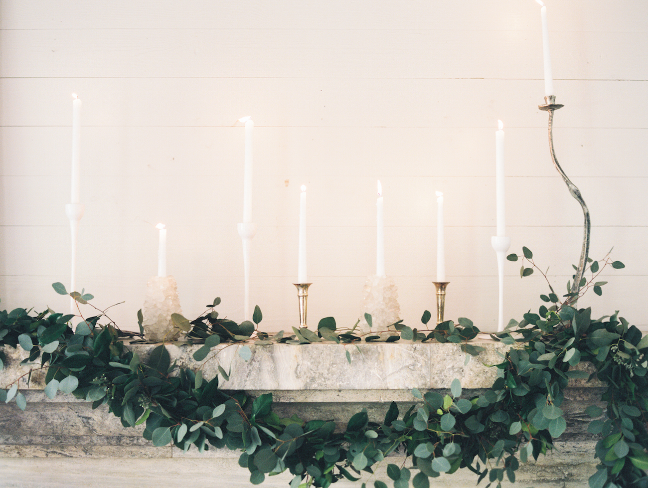 fireplace with marble mantle and eucalyptus garland