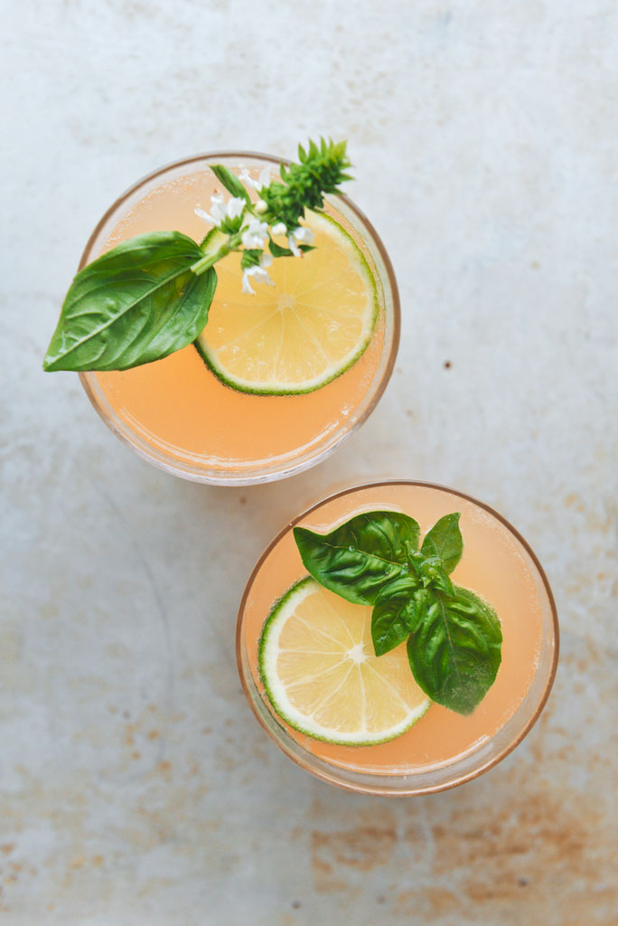 The most delicious lime grapefruit basil gin punch perfect for serving at summer parties