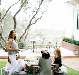 a low table and poufs for an al fresco summer meal