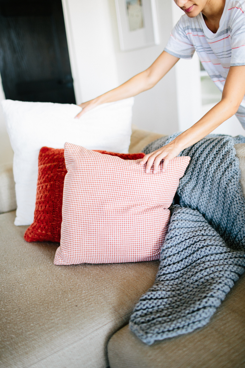 Adding cozy pillows and throw blankets for fall