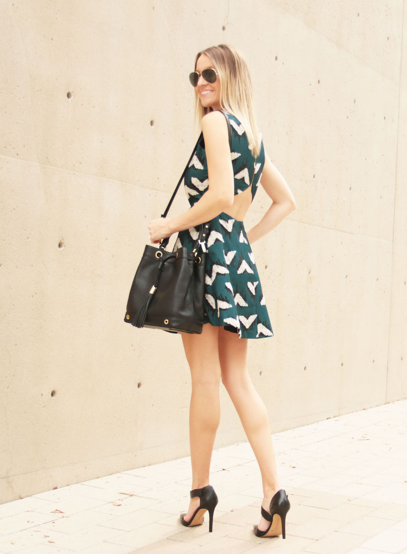 Loving the open back on this green dress.