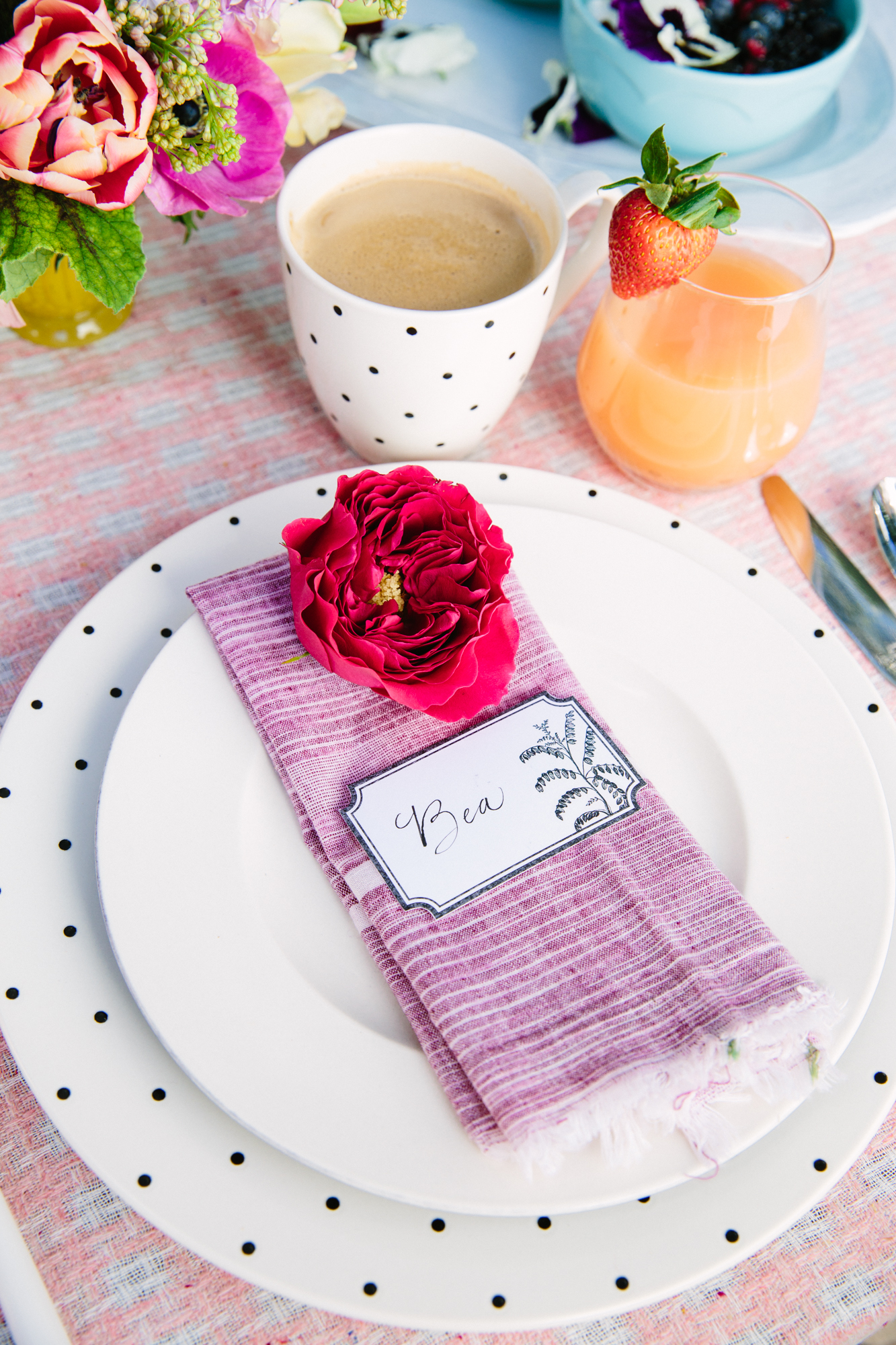 add a garden rose above each place card for the prettiest brunch table settings