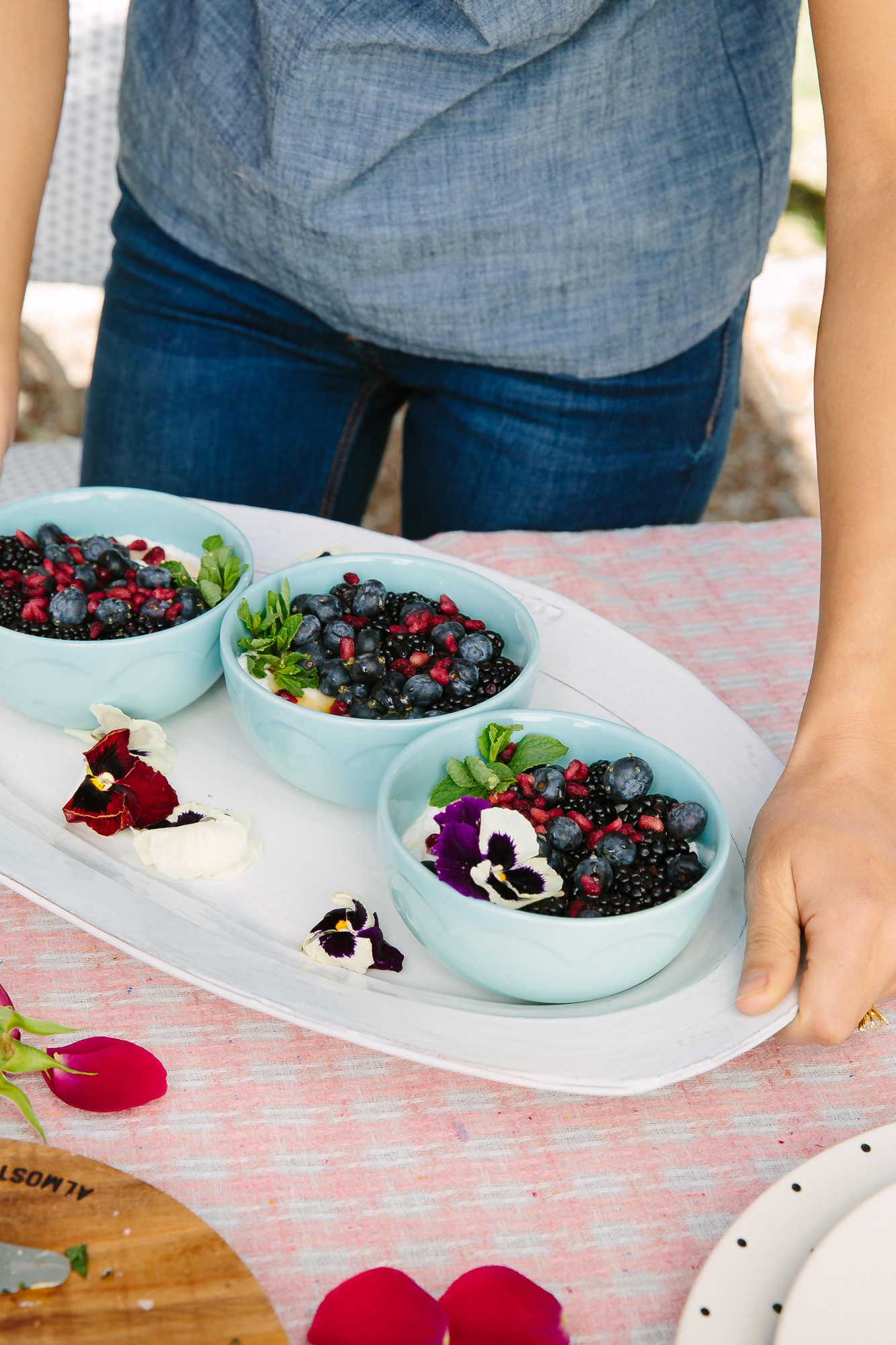 springtime yogurt bowls with berries & pomegranate seeds