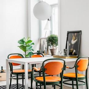 swedish dining room - love the bright pop of orange!