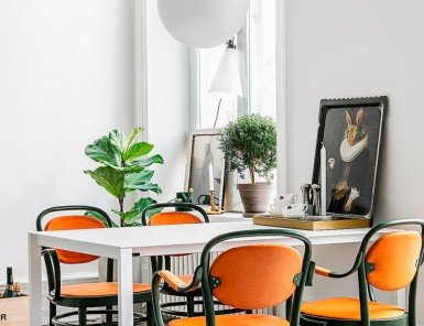swedish dining room - love the bright pop of orange!