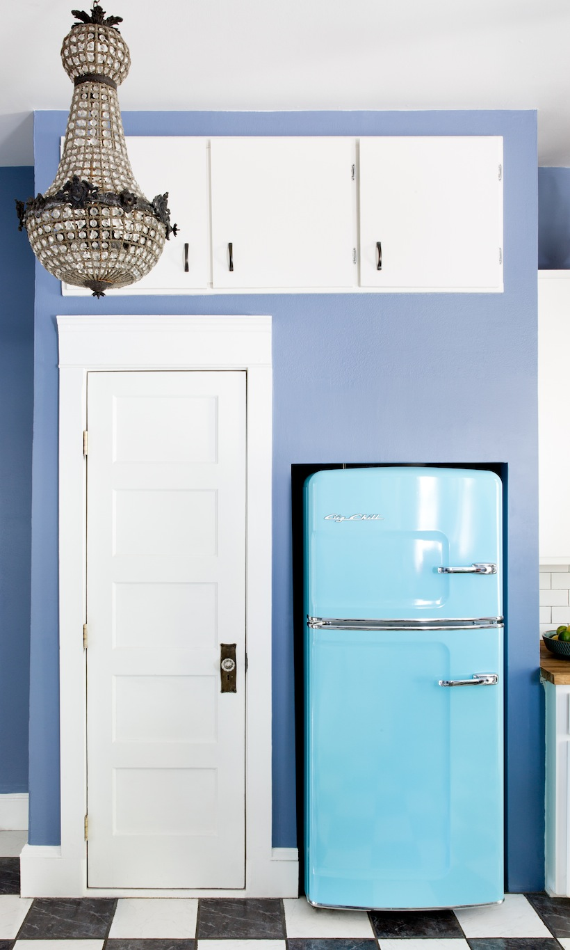 We only wish our kitchens could pull off this beautiful blue fridge like Kim West's does