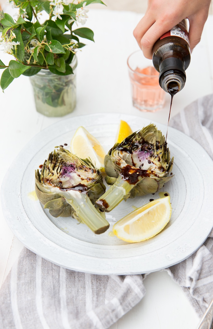 Drizzle some balsamic vinegar over boiled artichokes for a tasty treat at the table
