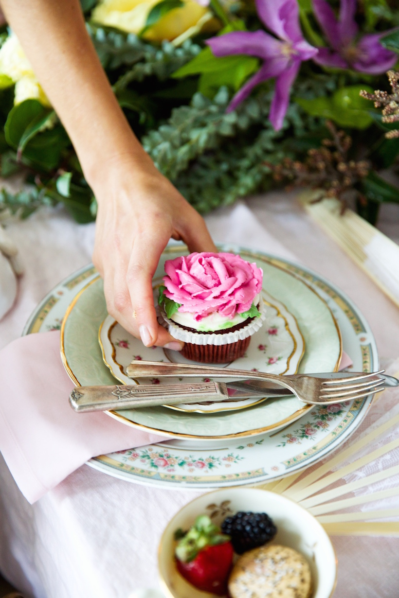 rose cupcake and mix and match china for a whimsical french themed table
