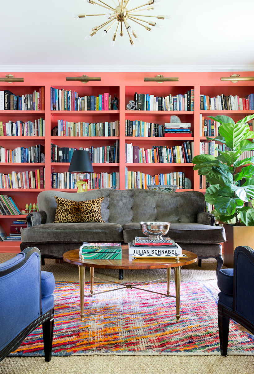 Salmon Painted Book Shelves in Colorful Living Room