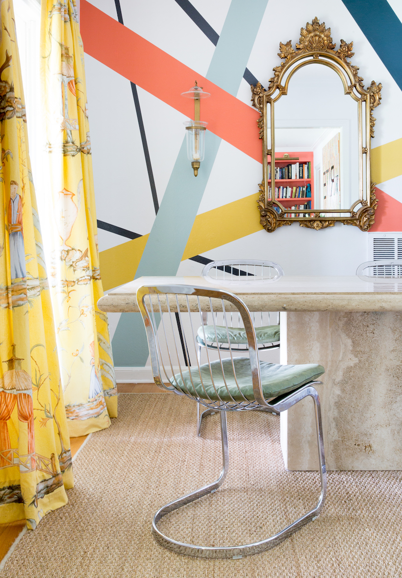 Patterned Painted Walls with Ornate Gold Mirror and Yellow Printed Curtains