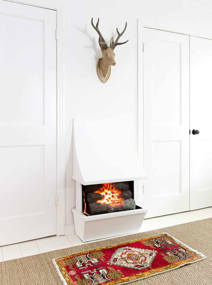 Unique White Built-In Fireplace with Interesting Architectural Details