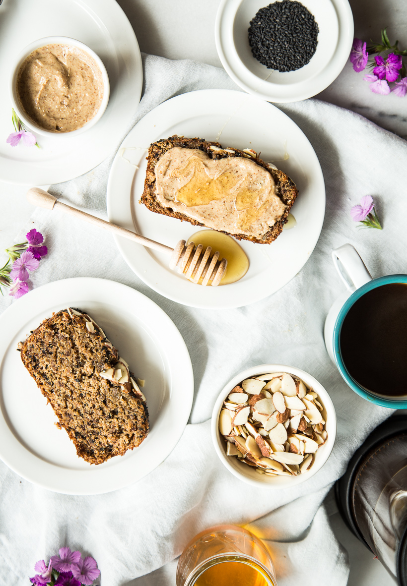 Treat yourself with this black sesame banana bread -- the tahini almond butter topping is to-die-for!