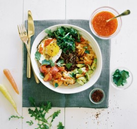 Quinoa bowl with harissa-roasted veggies, avocado, and fried egg