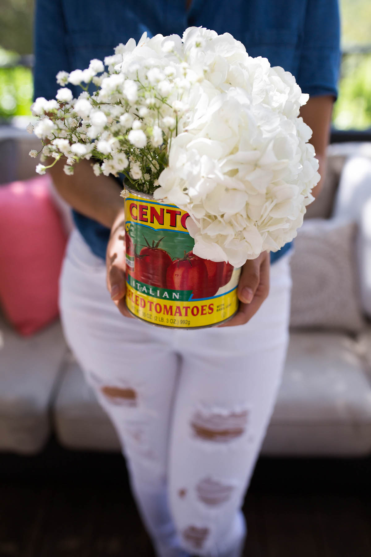 use a tin can as a vase for flowers!