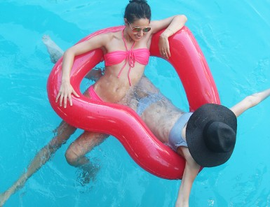 Adorable heart shaped pool float! WANT.