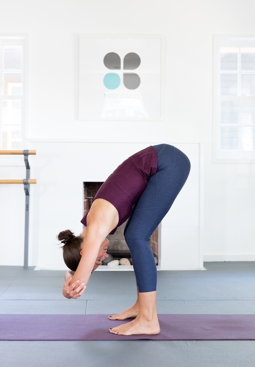 Standing Forward Bend - and 5 other yoga moves that promote calmness