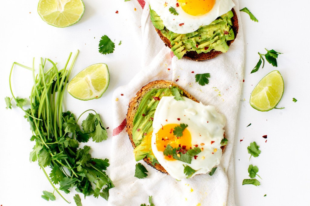 classic avocado toast with fried eggs, cilantro, & chili flakes
