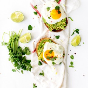 classic avocado toast with fried eggs, cilantro, & chili flakes