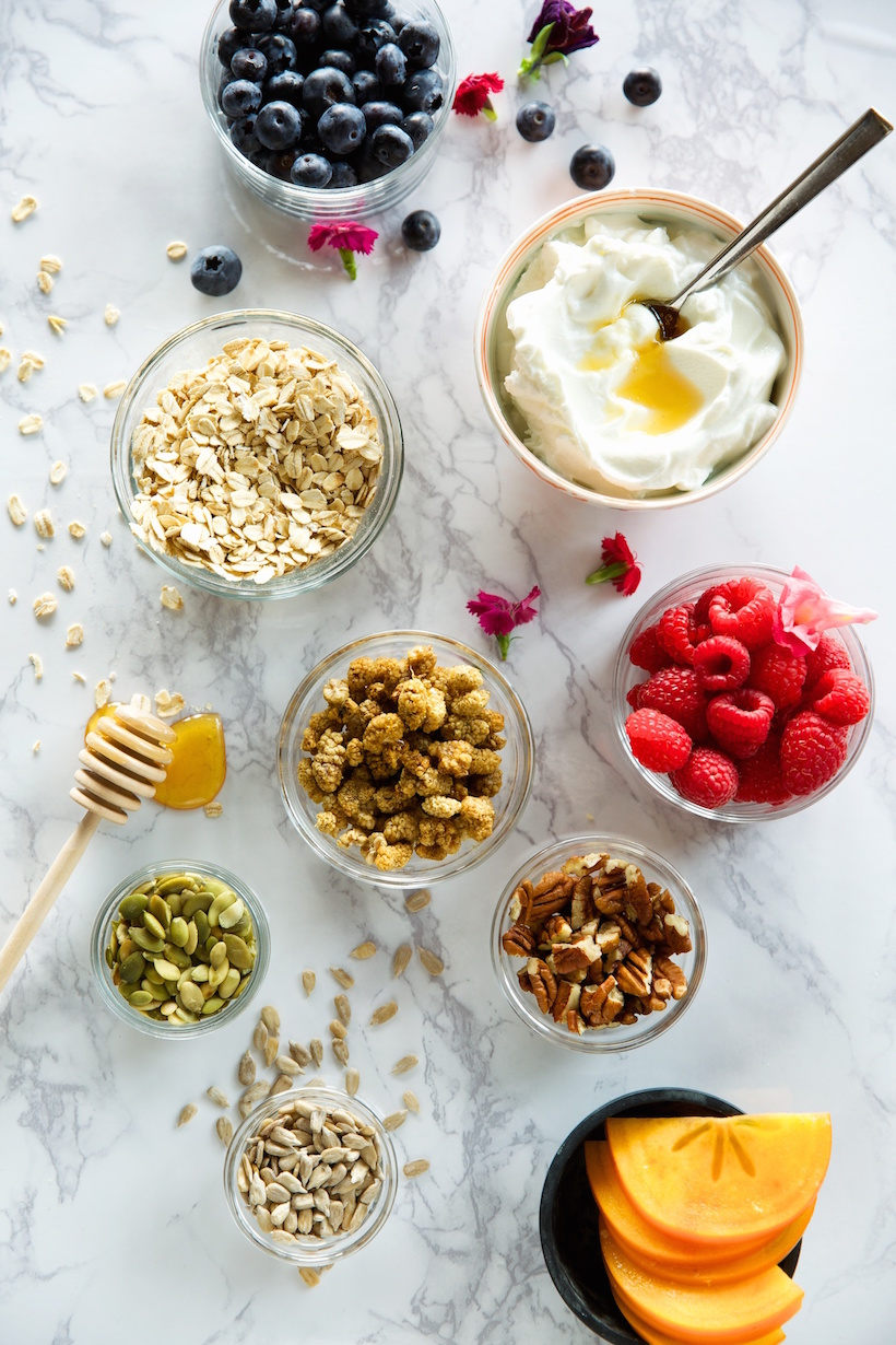 gluten-free coconut pecan granola with yogurt & berries