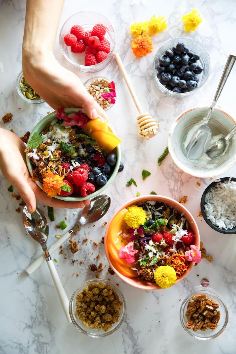 gluten-free coconut pecan granola with yogurt & berries