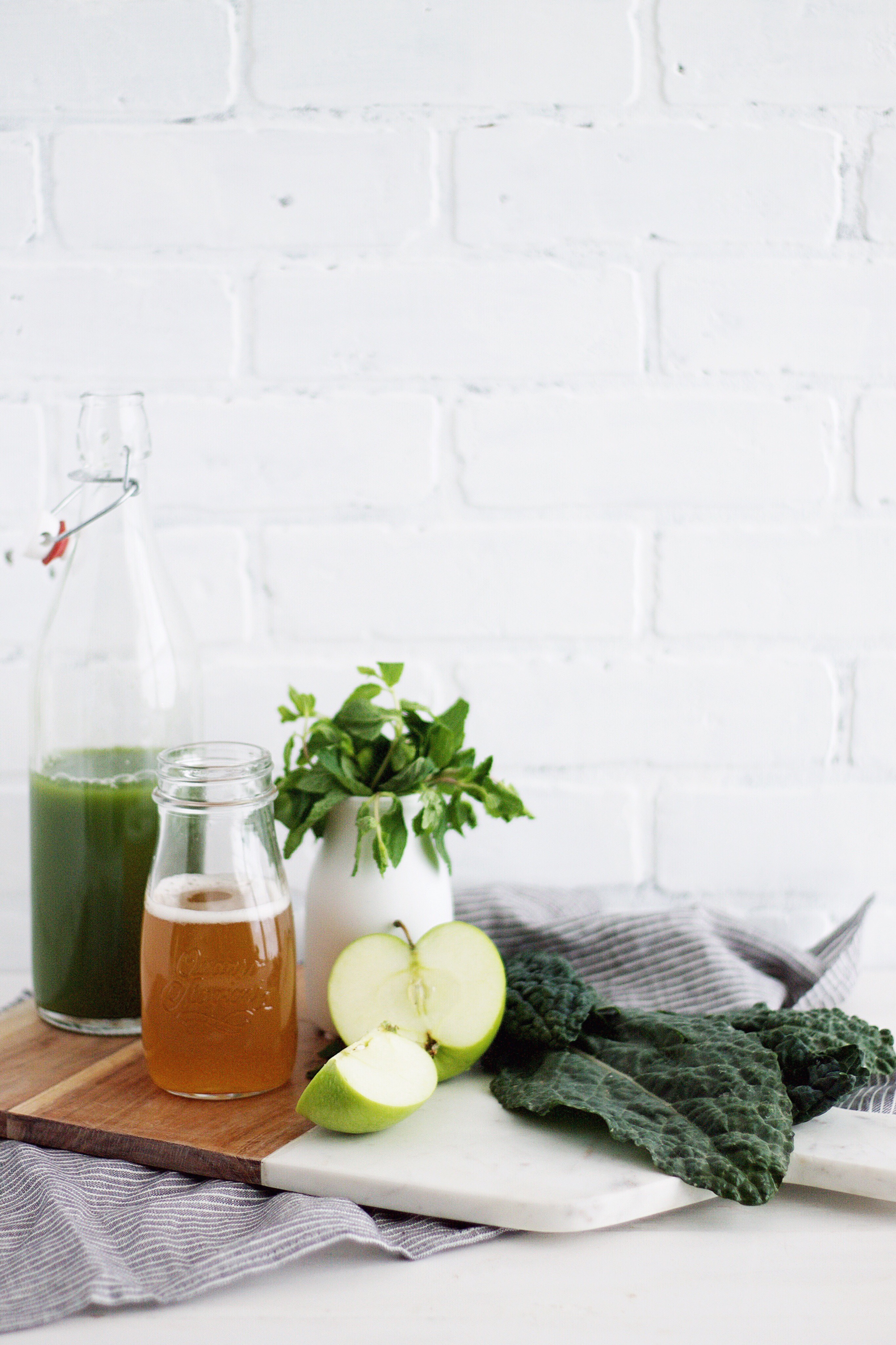 Start your day off with a minty kombucha mocktail made with all your favorite green juice ingredients