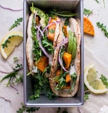 sweet potato pitas with arugula & garlic dressing