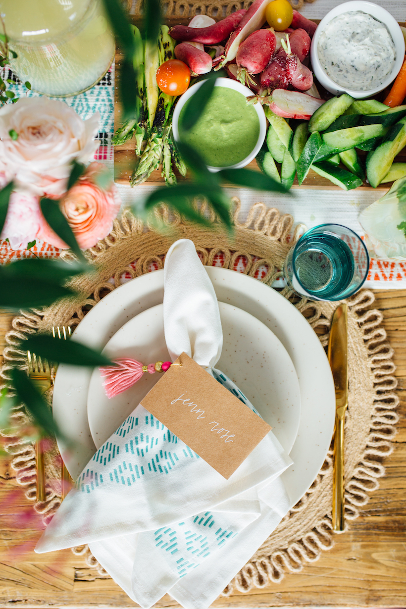 hand lettered calligraphy place cards on kraft paper