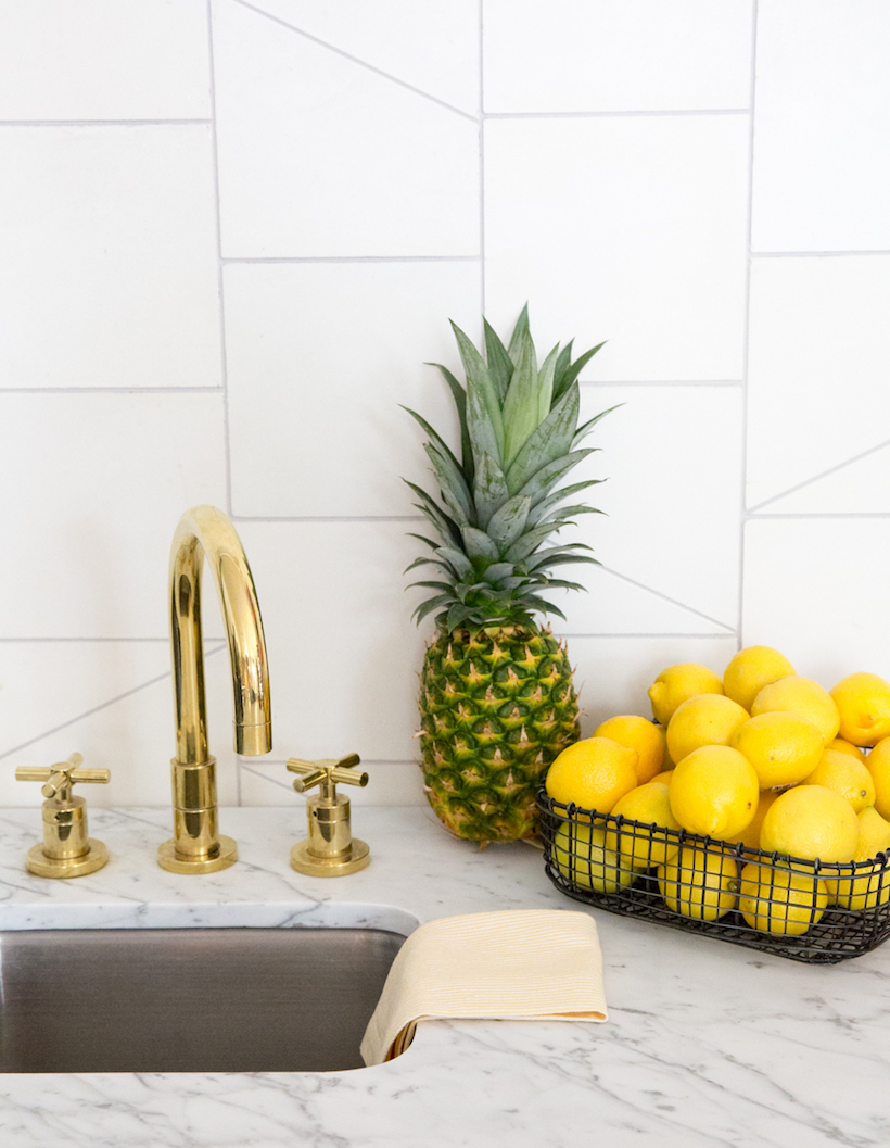 cute kitchen details with brass faucet