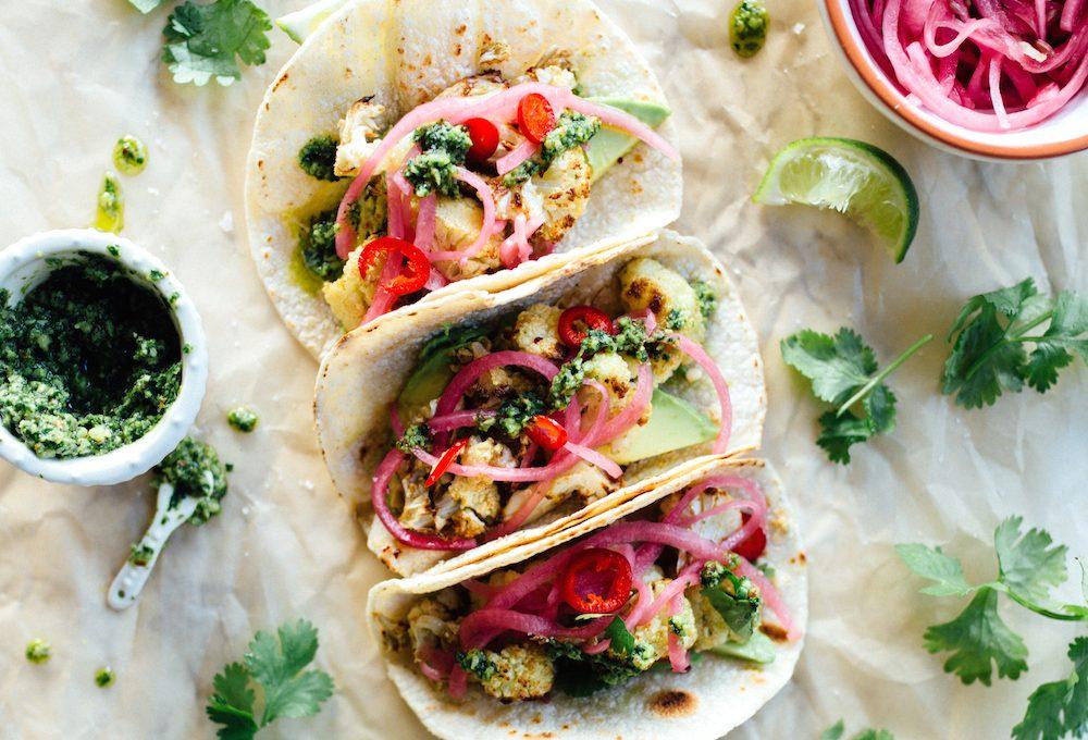 Roasted Cauliflower Tacos with Cilantro Pesto - a healthy, delicious (vegetarian!) way to satisfy those taco cravings