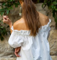 off-the-shoulder top and tassel earrings