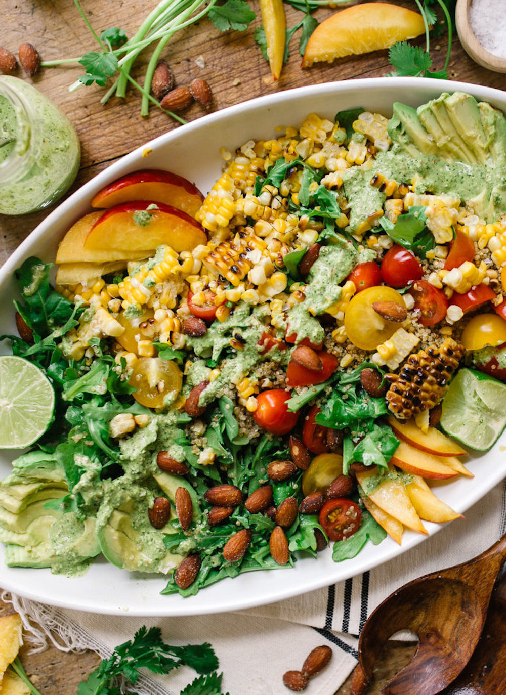 This southwestern superfood salad is bursting with tomatoes, peaches, and all my other favorite flavors of summer!