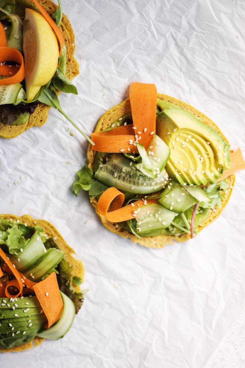 a salad topped socca pancake with a tangy herb sauce | This Brown Kitchen