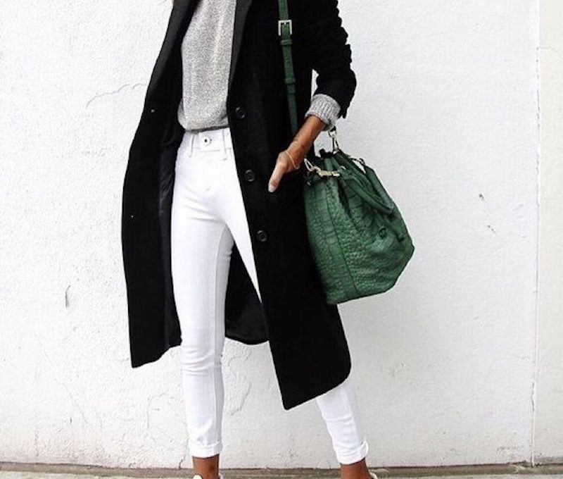 black long jacket, green bag