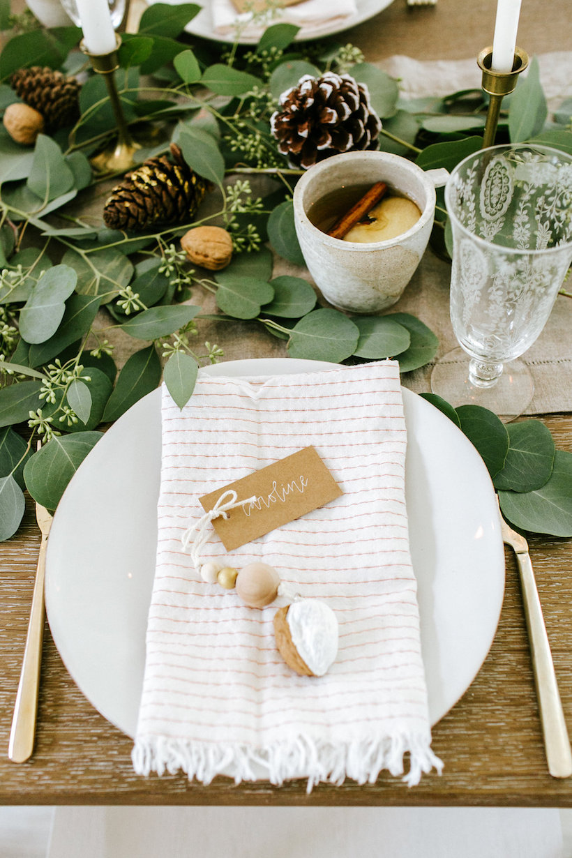 holiday party place setting with DIY ornament placecard