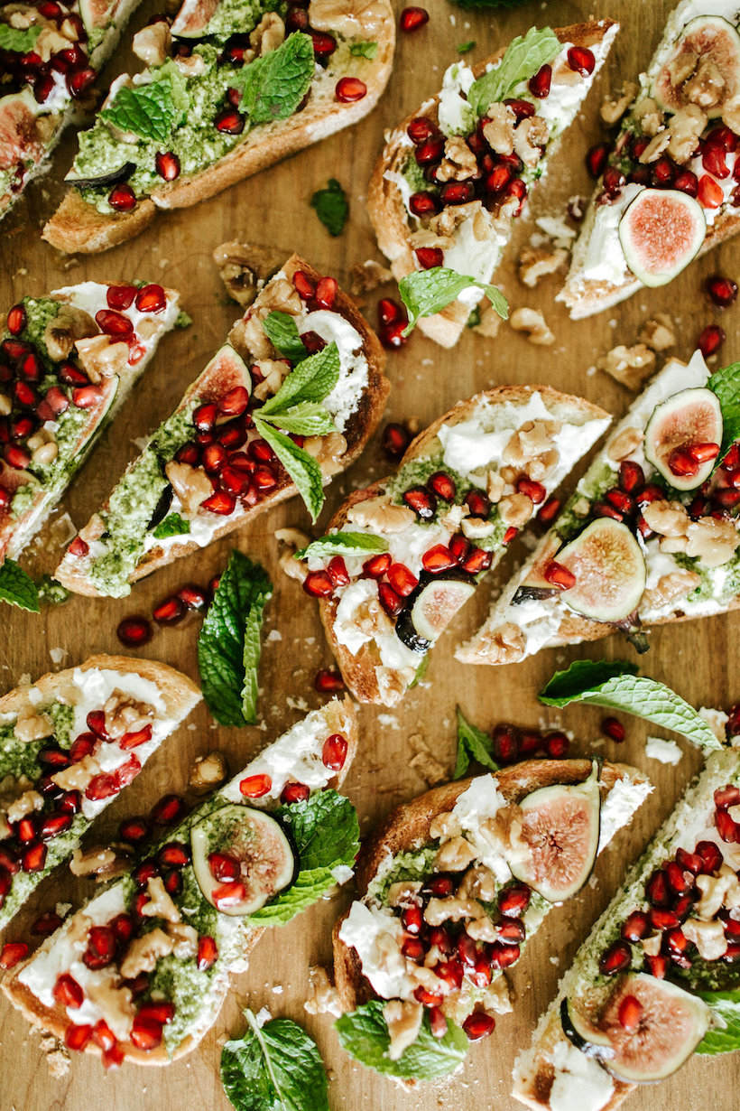 burrata toast with walnuts, figs, and pomegranate seeds