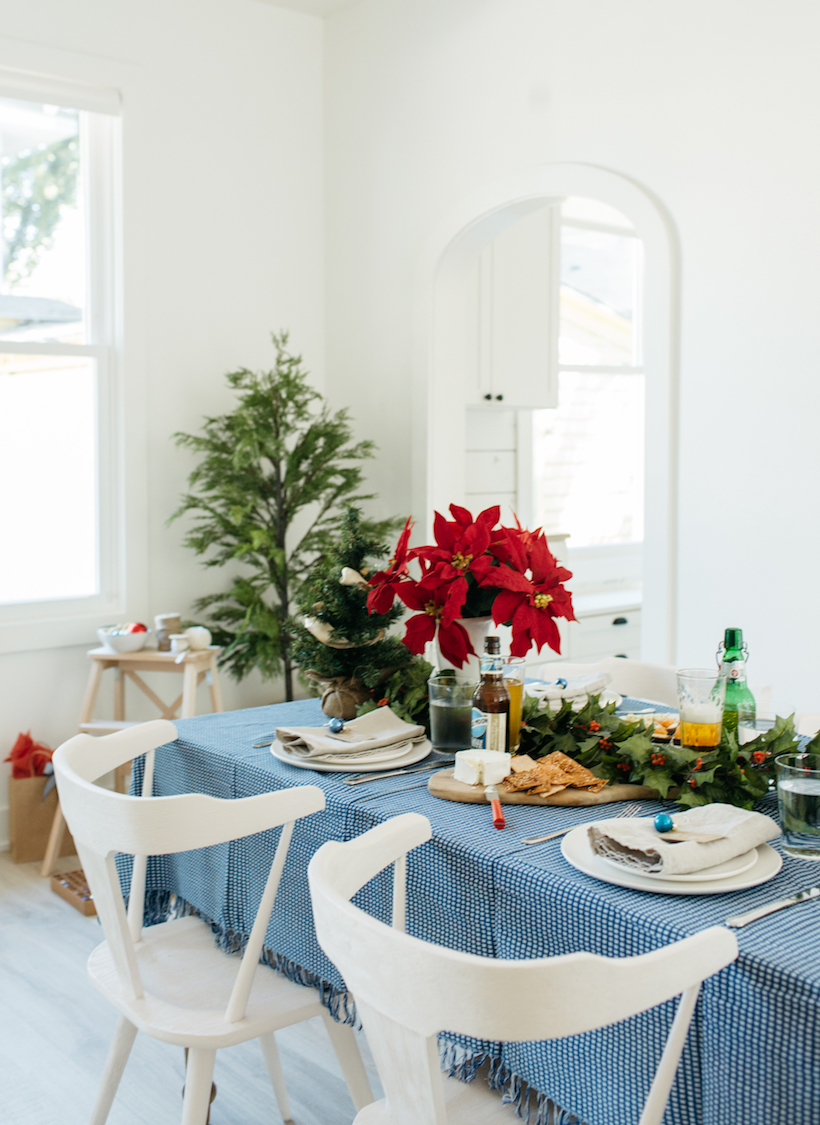 a blue and red holiday table